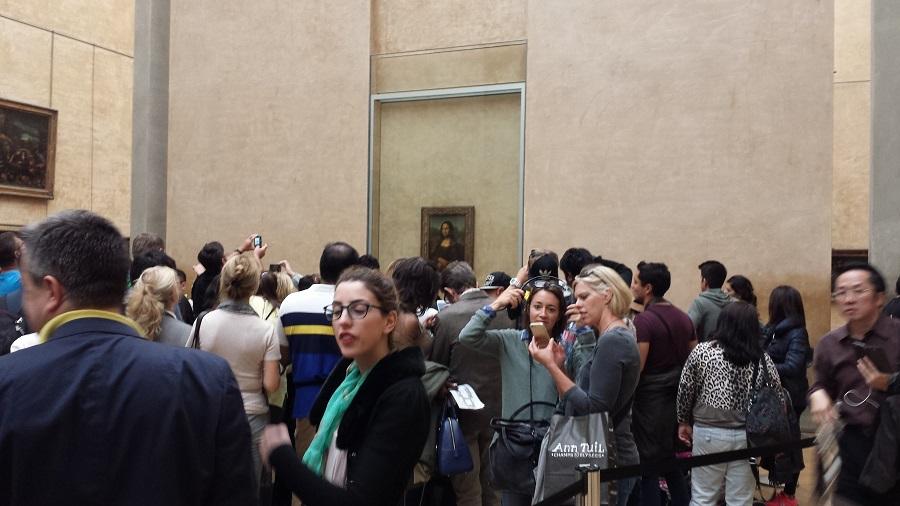 Mona Lisa, tá lá no fundo…